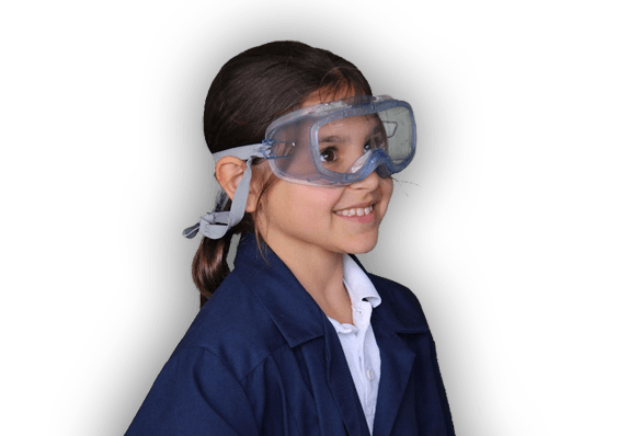 Girl in Lab coat, wearing safety glasses