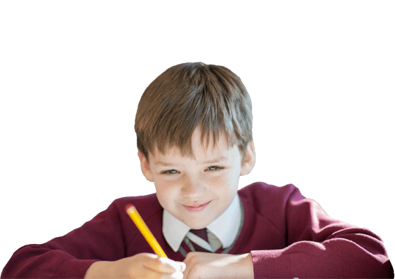 Young boy using a pencil in lesson