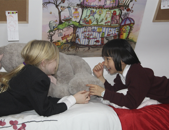 Two students in their room playing