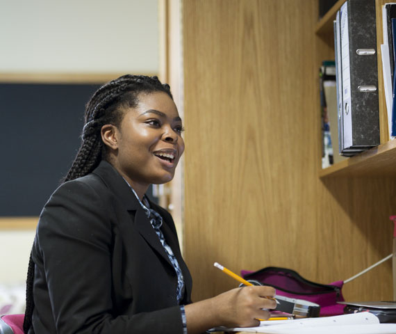 Student in boarding accommodation at their desk